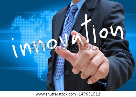 businessman hand pushing innovation button on a touch screen interface - stock photo