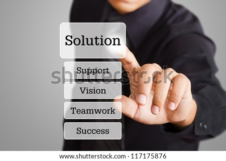 businessman hand pushing solution button on a touch screen interface - stock photo