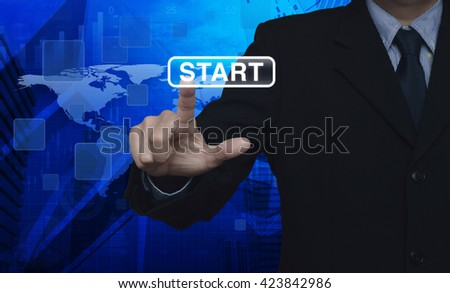 Businessman hand pushing start button touchscreen over map and city tower, Elements of this image furnished by NASA - stock photo