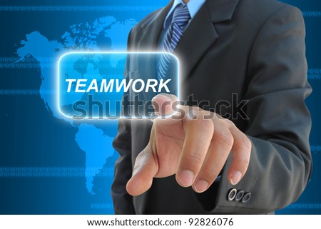 businessman hand pushing teamwork button on a touch screen interface - stock photo