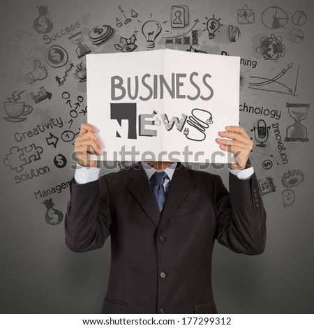 businessman hand show book of BUSINESS NEWS as concept - stock photo