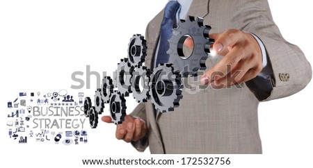 businessman hand show gear cogs and  business strategy as concept - stock photo