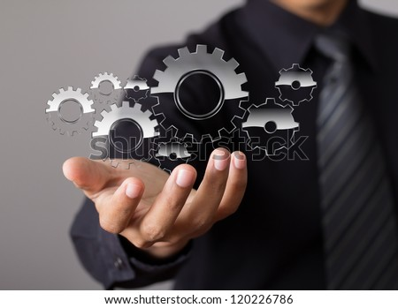 businessman hand show glass gear to success as concept - stock photo