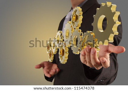 businessman hand show golden gear to success as concept
