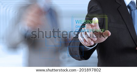businessman hand show webinar online conference as concept - stock photo
