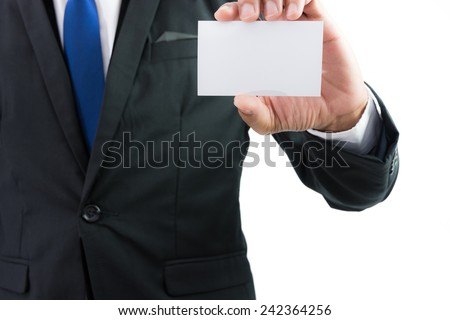 Businessman hand showing business card or note paper isolate on over white background - stock photo