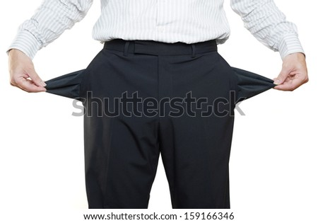 businessman hand showing empty pockets - stock photo