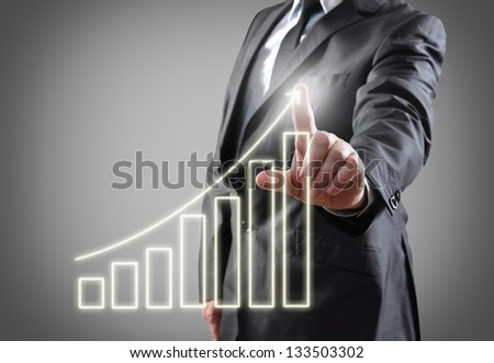Businessman hand showing graph on touch screen