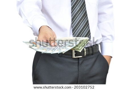 Businessman hand showing money - United States dollars (USD) - on white background - stock photo
