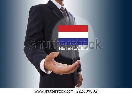 Businessman hand showing Netherlands flag