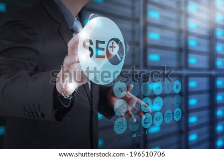 businessman hand showing search engine optimization SEO icon as concept  - stock photo