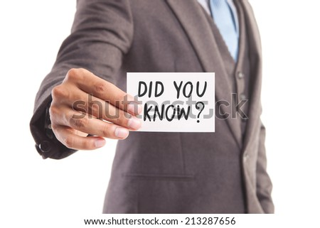 "Businessman hand showing someone his business card with""did you know?"" message - stock photo"