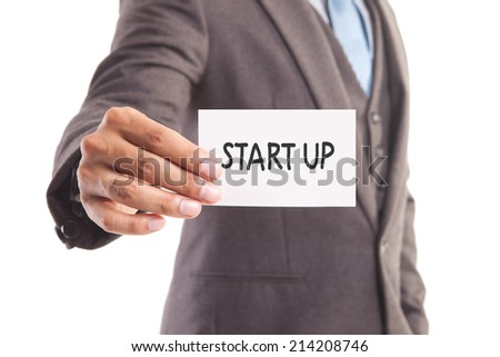 "Businessman hand showing someone his business card with""start up"" message - stock photo"