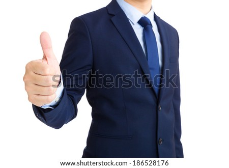 Businessman hand showing thumb up - stock photo