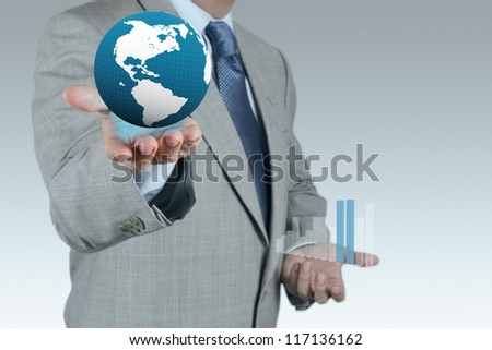businessman hand shows success and globe as concept - stock photo
