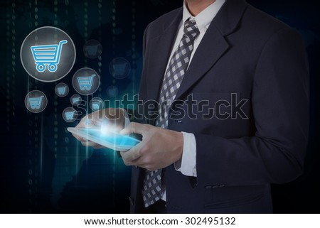 Businessman hand touch online shopping icons on a tablet - stock photo