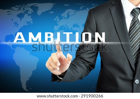 Businessman hand touching AMBITION sign on virtual screen