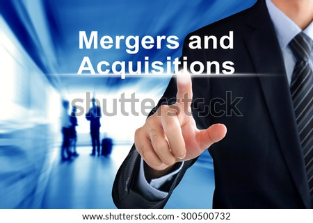 Businessman hand touching Mergers and Acquisitions (or M & A) text on virtual screen - stock photo
