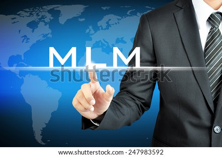 Businessman hand touching MLM (Multi Level Marketing) sign on virtual screen