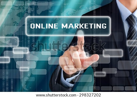 Businessman hand touching ONLINE MARKETING sign on virtual screen - stock photo