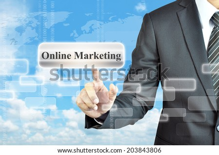Businessman hand touching Online Marketing words on virtual screen - stock photo