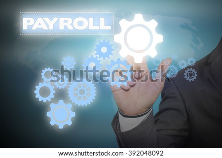 Businessman hand touching  PAYROLL tab on virtual screen , business concept , business idea