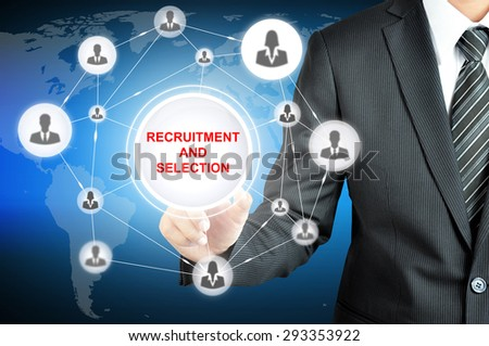 Businessman hand touching RECRUITMENT AND SELECTION sign on virtual screen with people icons linked as network - stock photo