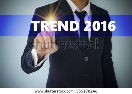 Businessman hand touching TREND 2016