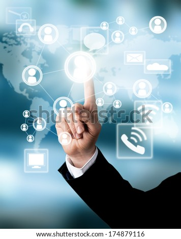 Businessman hand touching virtual scheme with icons - stock photo