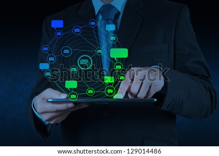 businessman hand use tablet computer with email icon as concept - stock photo