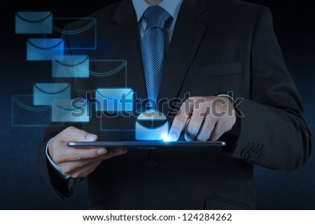 businessman hand use tablet computer with virtual email icon - stock photo