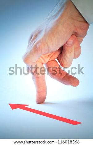 Businessman hand walking in direction of red arrow. Progress metaphor - stock photo