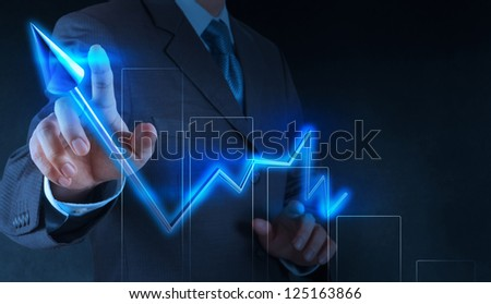 businessman hand with a pen drawing light bulb on touch screen computer - stock photo
