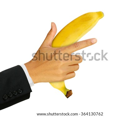 Businessman hand with banana gun, over white - stock photo