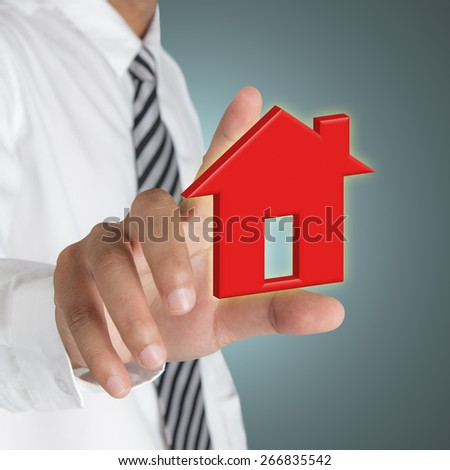 Businessman hand with home icon