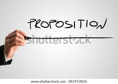 Businessman Hand with Marker Writing Underlined Proposition Text Against Abstract Gray Background.