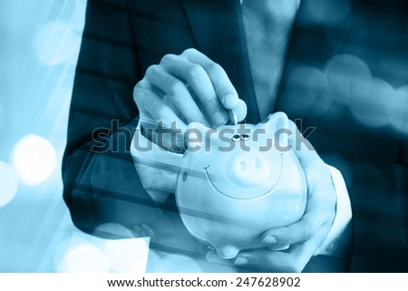 Businessman hand with piggy bank - stock photo