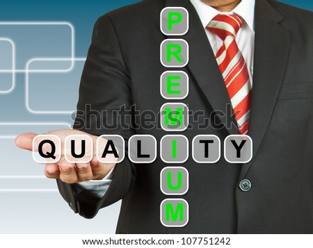 Businessman hand with text Premium Quality - stock photo