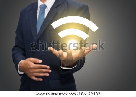 Businessman hand with wifi.  - stock photo