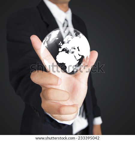 Businessman hand with World Map and Globe icon