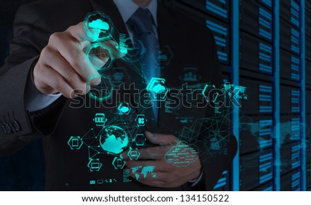 Businessman hand working with a Cloud Computing diagram on the new computer interface - stock photo