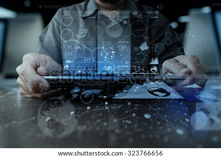 businessman hand working with modern technology digital tablet computer and digital layer effect as business strategy concept - stock photo