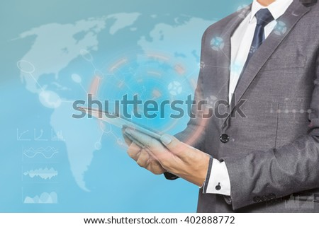 Businessman hand working with modern technology digital tablet computer and digital layer effect as business strategy concept