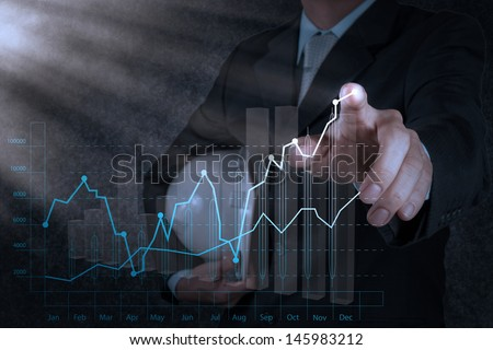 businessman hand working with new computer interface show building development concept - stock photo