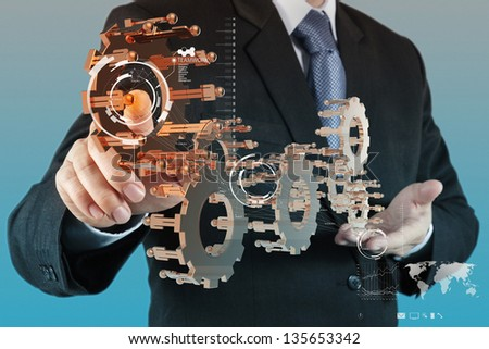 businessman hand working with new computer interface show gear to success as teamwork concept