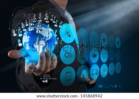 businessman hand working with new modern computer show the earth social network structure