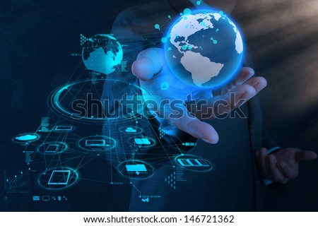 businessman hand working with new modern computer show the earth social network structure as concept - stock photo