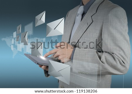 businessman hand working with tablet computer sending email - stock photo