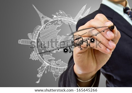Businessman hand write Travel concept in the world - stock photo