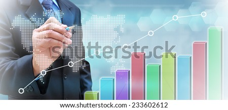 businessman hand writing a business graph on a touch screen interface